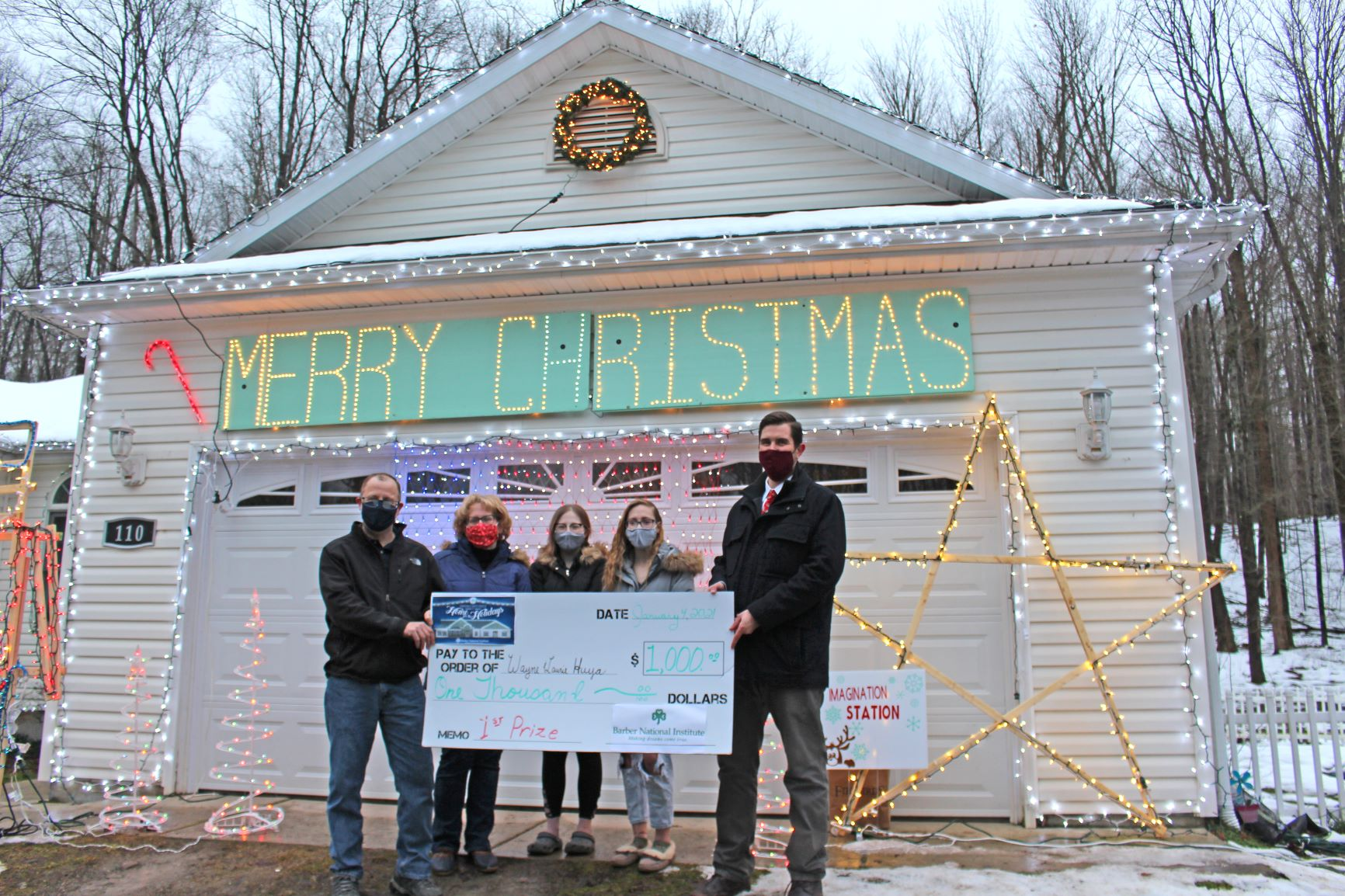 Awarding first place house display winners with check