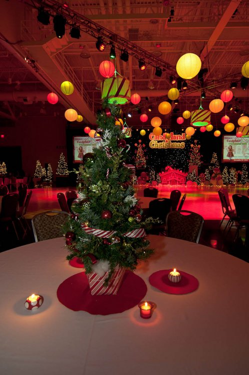 An assortment of lighted centerpieces was prepared by Allburn Florist.