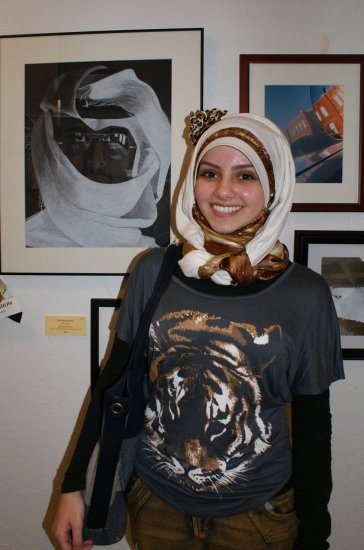 "Youth Best of Show winner Yassar Al-Fatlawi, a 17-year-old student at Collegiate Academy, with her work in colored pencil, ""Mirage of Home."""