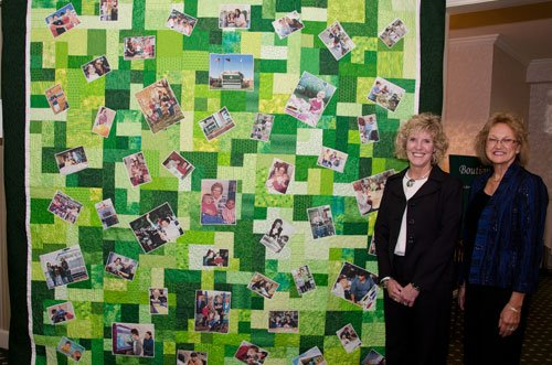 "Jan Brabender and Darlene Orschek, creators of ""Field of Dreams,"" a quilt commemorating Dr. Barber's 100th Birthday"