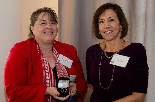 Julie Sanner, right, presents the Premier Prize, a pair of diamond earrings donated by Dahlkemper's Jewelry Connection, to lucky winner Kathy Bastow.