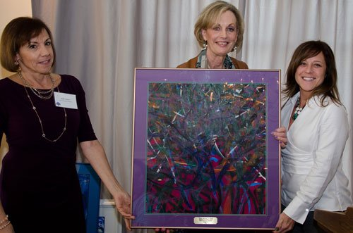 2012 Chairwoman Julie Sanner and Maureen Barber-Carey present an appreciation gift to Kim Misko for the sponsorship from Eriez Magnetics