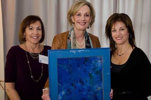 Patty Bloomstine, left, accepts an appreciation gift for the sponsorship from Insurance Management Company