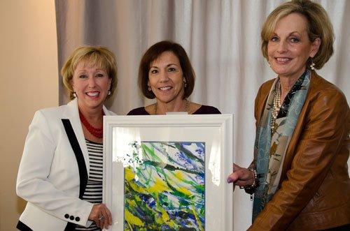 Lisa Watkins, left, receives an appreciation gift on behalf of KimKopy Printing