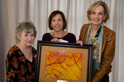 Laurie Treadway, left, accepts an appreciation gift on behalf of the McCain Foundation, Inc.