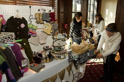 Owners Amy Snyder and Miriam Welcheck set up Olive Ewe Baby's collection of environmentally friendly clothing, hats, toys and accessories for children