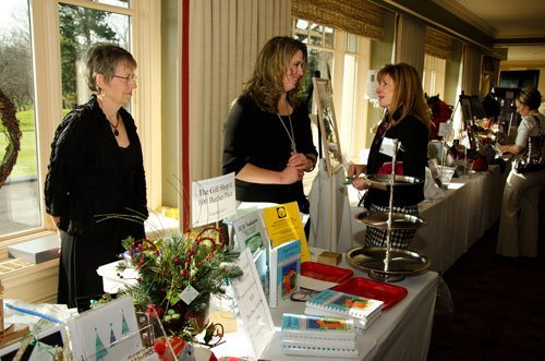 """Edie Stansbury, left, and Parent Group President Marci Smith sold """"Angels in the Kitchen,"""" and offered luncheon guests tasty treats from the cookbook"""