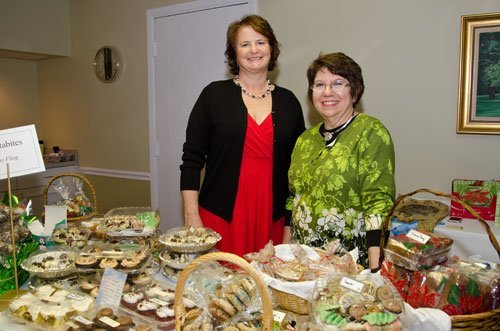 Judy Stewart, left, and Kathy Fling, owner of Delectabites, display cupcakes, cookies and desserts for sale