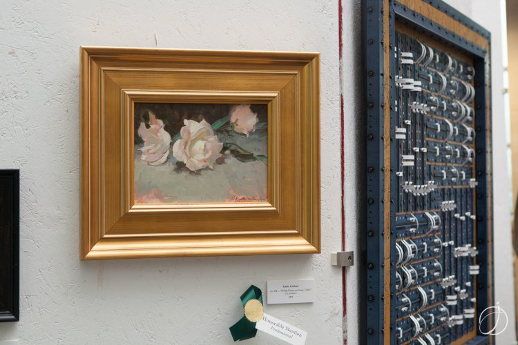 """White Roses on Gray Table,"" an oil painting by Kathe Umlauf that won an honorable mention award in the adult amateur category"