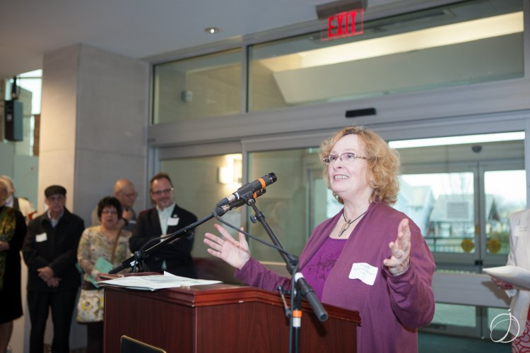 Art Show juror Peggy Merrill Brace offers congratulations to the group