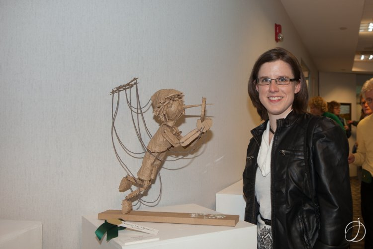 "Artist Rebecca Merry with ""Lies We Tell Ourselves,"" her paper sculpture that was awarded an honorable mention award in the amateur artist category"