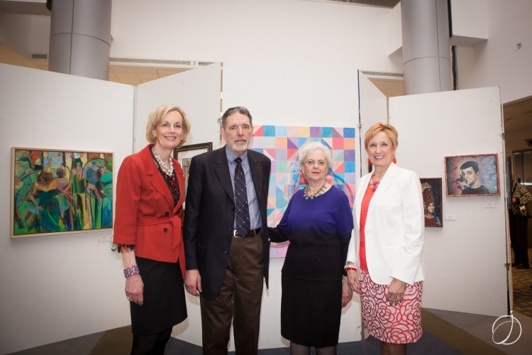 Dr. Maureen Barber-Carey, left, and Bridget Barber, right, thank Dr. Robert and Betsy Guelcher for their support of the Art Show