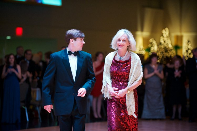 Executive vice president Dr. Maureen Barber-Carey, escorted by her son, Ryan Carey.