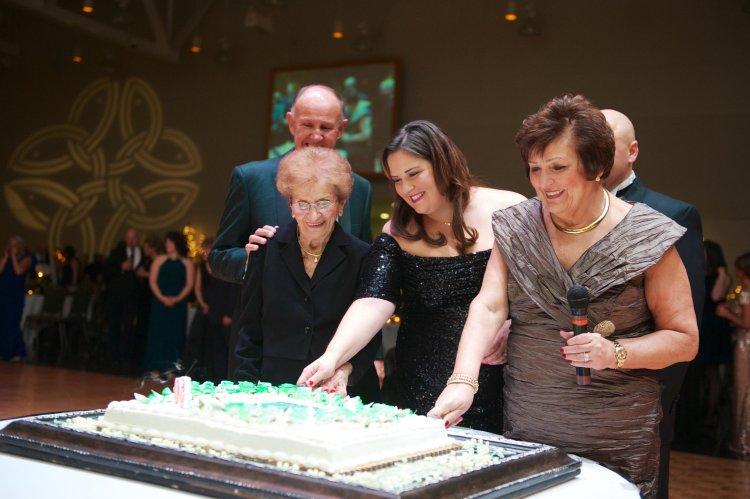 Marlene Mosco and Emily Merski cut the anniversary cake.