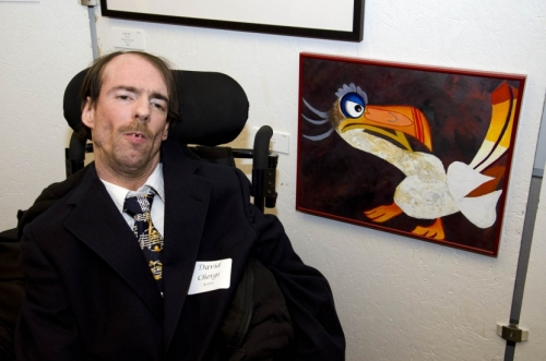 "David Chergi with his painting, ""Zazu."""