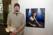 "Artist Justin Poole, who has won awards in previous Art Shows, with one of his entries for this year, ""Arcanum."""