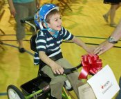 Adaptive bikes given to 31 kids as part of partnership
