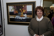 "Artist Mary Hamilton with her painting, ""Cutwork Lace and Chinese Lanterns."""