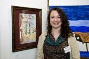 Artist Kathleen Murzynski with her artwork.